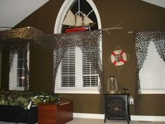 Using tree branch for curtain rod.. Sam did this for his room... Cool look.