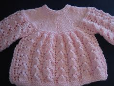 This is a hand knitted Pink Lace Baby Girl Sweater, Bonnet and Booties set. Made with very soft pink color baby yarn. Accented with pink ribbons and pink color buttons.    This adorable set fits newborn to 3 months old babies and also fits life size reborn dolls. This set makes a wonderful gift for a baby shower, christening or christmas. Also wonderful heirloom pieces for your own baby girl.    Hand knit work - just WONDERFUL. Comes from clean smoke and pet free home...