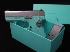 For the girl who doesn't do pink... a Kahr Arms 9 mm semi-auto handgun in eye-catching teal with matching case.