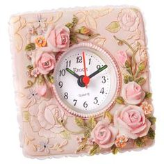 Embossed floral table clock with light-up hands.  Product: Table clockColor: Pink and whiteFeatures:  Rococo style with rose reliefQuartz movement Accommodates: (1) AA Battery - not includedDimensions: 4.5 H x 4.5 W x 1.8 D