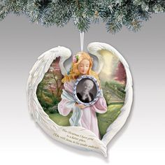 "Remember your loved one this and every Christmas with the Thomas Kinkade ""Always in our Heart"" Remembrance Ornament. This ornament features a sculpted, hand-painted angel holding a frame into which you can place an image of your loved one. The angel's spread wings reveal the inspiring painting Stairway to Paradise. On the reverse of the ornament is a poem with a message of comfort. This ornament comes with a frame to keep the one close to your heart always near."