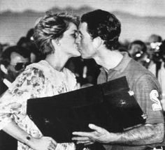 Princess Diana kisses Prince Charles after giving him his runners up prize at the Royal Oman Polo Ground , November 12, 1986.