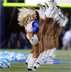 Cowboy cheerleaders. I love how high they can kick. They def must work hard in practice!