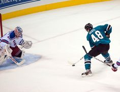 San Jose Sharks rookie forward Tomas Hertl breaks in all alone on New York Rangers goaltender Martin Biron during the second period (Oct. 8, 2013).