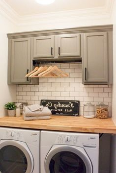 Farmhouse inspired laundry room with modern white subway tile and gray cabinets.Farmhouse inspired laundry room with modern white subway tile and gray cabinets. Don't forget the bar to hang clothes! Rustic Laundry Rooms, Mudroom Laundry Room, Laundry Room Remodel, Laundry Room Cabinets, Small Laundry Rooms, Farmhouse Kitchen Cabinets, Laundry Room Organization, Laundry Room Design, Organization Ideas