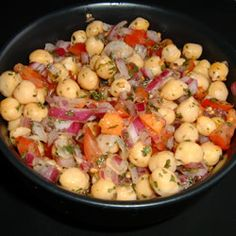 This is in the fridge right now! Didn't have fresh parsley though......Chickpea Salad with Red Onion and Tomato Allrecipes.com