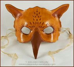 Very good griffon mask,  moulded leather,  love the natural colour choices