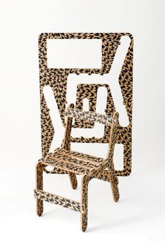 Own: Ben Wilson Vs. EleyKishimoto 'Chairfix Flash' in MDF/Ink. Not assembled;  integrated into self-designed table.