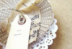 cupcake liner + doily + pattern paper + gift tag + twine