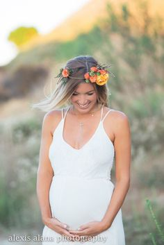 Maternity shoot perfected with a brightly colored floral crown- baby garden roses and rannunculas| The Eleventh Flower, phot cred: Alexis Alana Photography Orange, flowers, floral, crown, maternity, photoshoot,