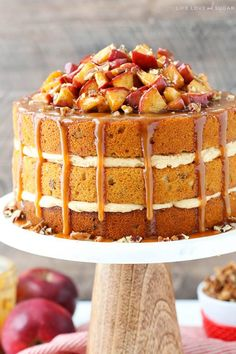 Caramel Apple Pecan Layer Cake - layers of spiced cake with pecans, caramel frosting and cinnamon apples all drizzled with caramel sauce!