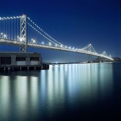 Reflections of the Bay Bridge on the water