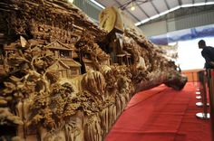 This is the World's Longest Wood Carving. It was Made from a Single Tree Trunk - An astonishing wooden sculpture by Chinese artist Zheng Chunhui. The wooden carving took four years to complete. The sculpture, carved from a single tree trunk, measures 12.286 meters long, 3.075 meters high and 2.401 meters wide (40.308 x 10.088 x 7.877 ft).