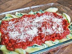 Spinach Stuffed Shells with Meat Sauce: Jumbo shells, spinach, ricotta, mozz and parm cheese, spag sauce, salt, pep, & gar powder. Cook pasta & spinach, drain and dry; in bowl combine spinach, ricotta, cheese, salt, gar powder, & pepper. Cover dish bottom with red sauce, fill pasta shells w/ mixture, place in dish, and top with more red sauce w/ cheese on top. Bake for 15-20 min.