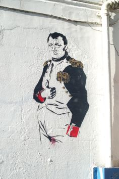 This image was created using stencils and spray paint or even just paint to make is on the white wall of the side building.