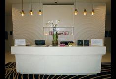 minimal white reception desk
