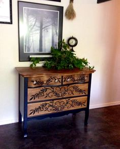 Serpentine Dresser with black had painted design I refinished