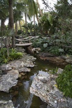 Raymond Jungles designed gardens are my favorites Tropical Landscaping, Tropical Garden, Backyard Landscaping, Hillside Garden, Garden Bridge, Garden Pond, Garden Stream, Beautiful Landscapes, Beautiful Gardens