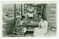 Early postcard of three Cherokee Women in NC. Two are handburnishing coiled pottery and one is beading. Samples of Cherokee pottery are displayed on the porch. Clapboard house, wide boards, signs of hand marks, simple sills. Typical southern caned chairs, one iwth simple finials, one more ornate.