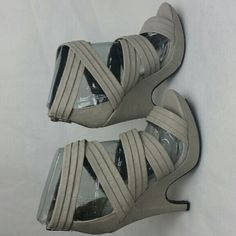 Women's BRAND NEW gray open toe heel shoe size 8 BRAND NEW  NEVER BEEN WORN  Gray thick cross cross strap heel(4 inch) open toe shoe with zippered back.  Questions about this listing? Feel free to message me. Thanks for shopping :) Bamboo Shoes Heels