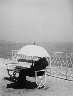 """Brassai, The Man With White Umbrella, 1934 """