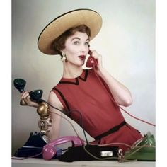 • Call Me • Model Evelyn Tripp wears a sleeveless red linen dress by Larry Aldrich with a hat from Lilly Dache. Photographed by Erwin Blumenfeld in #Vogue US, April 1953. #fashion #vintagevogue