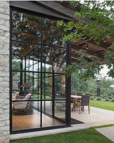 Steel windows, pergolas and concrete pavers make an outdoor entertaining area instantly possible. Design Exterior, Modern Exterior, Stone Exterior, Custom Home Builders, Custom Homes, Nature Architecture, Windows Architecture, Steel Windows, Iron Windows