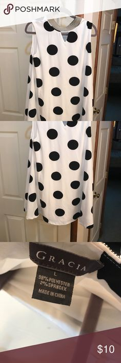 Garcia Black and white polka dot dress This is a very cute Polka Dot Garcia Dress size large!  It reminds me of a dress Lucille Ball would of worn being pregnant! It's looks so retro and fun! It's in excellent condition! Wear it with black or white sandals for a very stylish look! It's like a swing dress! Garcia Dresses