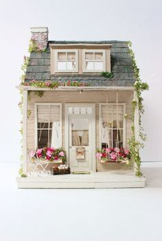 My newest dollhouse is The Old Country house. This is a 2 story custom house built from scratch. On this house I used a ready made door a...