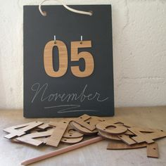"""Perpetual Calendar chalkboard from Decoylab: bamboo << would also work as a """"sleeps until' countdown"""