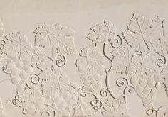 Élément en L en béton pour retenir la terre; muret préfabriqué en pierre reconstituée. Finition surface: Vignes.