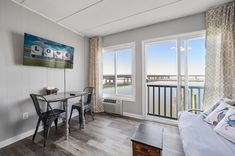 Welcome to The Pearl at Marsh Island - leave your troubles at the door, you won't be needing them here! This super charming and newly renovated 1 Bedroom/1 Bath Condo will make you feel a million miles away from the real world. Chincoteague Island Rentals, The Real World, Condominium, Seaside, Doors, Vacation, Pearls, Bedroom, Bath