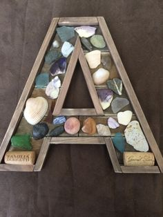 Letter with sea glass shells and corks