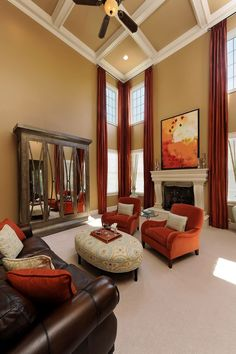 the orange tub chairs can work with the leather sofa down in the basement if not in the living room