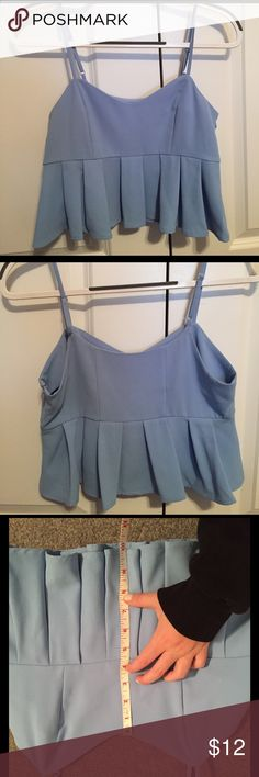 Sky blue peplum tank crop top NWOT sky blue crop top with peplum feel. Shirt is crop top- for shorter girls (5'0) can come to top of jeans. Forever 21 Tops Tank Tops