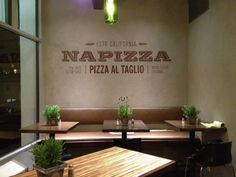 Miller Creative was tasked with naming, tagline, creating a restaurant brand identity, environmental branding, menu design for wall and tables, pizza boxes and website for Napizza, a pizza restaurant specializing in pizza al taglio.