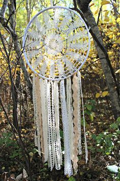 OOAK Large cream/neutral dreamcatcher Measures 14 across and 42 long from the top of the hoop. It will add the perfect touch to any room! The