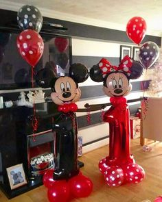 Happy First Birthday! Decoration with balloon numbers and mickey and minnie mouse.
