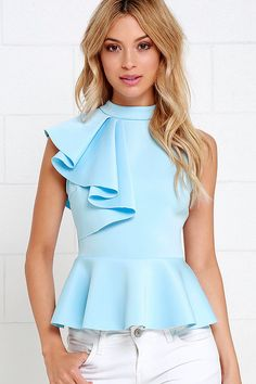 It's incredible how unforgettable you will be in the Forever More Light Blue Peplum Top! Poly-spandex, medium-weight knit hugs your silhouette from a mock neck, through a sleeveless bodice decorated with a cascading side ruffle. A peplum tier flares from Trendy Tops, Cute Tops, Casual Tops, Mode Top, Elegantes Outfit, Look Fashion, Fashion Design, Mode Style, Dress Patterns