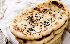 This recipe for naan is so pillowy, you'd never guess that it's gluten-free. These breads are best served while still fresh and warm, ready to eat with your favorite curry or biryani re…