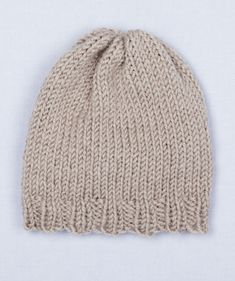 Loom Knit Simple Hat- Simple to knit with your Martha Stewart Crafts Knit & Weave Loom Kit, this hat is knit in the round and closed at the top to form a traditional beanie-style cap. Ribbing along the bottom edge assures a comfortable, stretchy fit and a brim that won't roll backward.