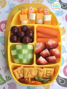 Both girls had cheddar & mozzarella cheese, carrots, red grapes, strawberries, apples & goldfish crackers.I used alphabet bento picks & Scrabble Cheez-it crackers to spell their names.