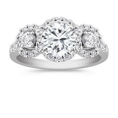 14K halo engagement ring featuring round brilliant cut diamond. Available with your choice of diamond, ruby or sapphire.
