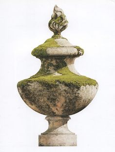 Garden antiques, such as these finials, are sold on the patio outside...