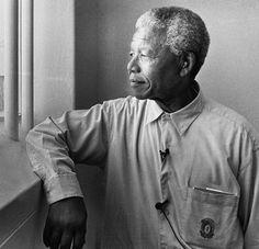 Photo by Jürgen Schadeberg (born 1931), 1994, Nelson Mandela in his cell on Robben Island (revisit).