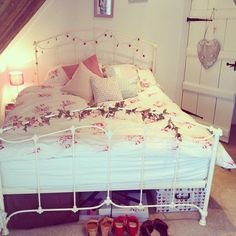 Love the bed frame + wrapped lights & the pillows