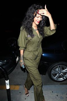 Rihanna stepped out in an army green jumpsuit and and a red lip