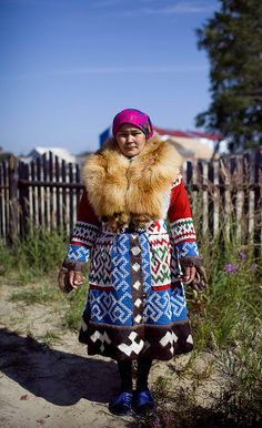 This woman is from the Khunty tribe. An endangered indigenous people who live in Russia and Mongolia. Their clothing is beautiful.