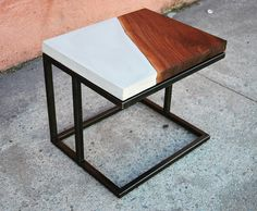 """First look at the """"Resolve"""" End Table… Live Edge Black Walnut sits perfectly Opposite a Sealed Concrete slab on a Hand Blackened and Waxed Steel Frame. . . . . . #Design #welding #woodwork #concrete..."""