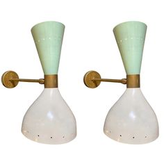 Pair of Italian metal sconces in the style of Stilnovo. Off-white metal shade with brass detailing and back-plate.Sconces shine both up and down light. Wired to American standards. Wall Sconce Lighting, Wall Sconces, Mid Century Lighting, Italy Fashion, Downlights, Light Bulb, Mid-century Modern, 1960s, Wall Lights